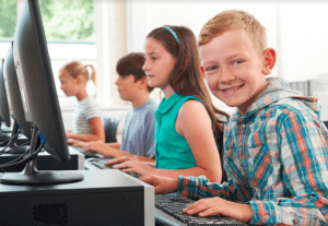 kids learning computer programming in school